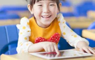 school child with ipad