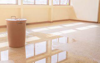 maintain school facilities. Image of roof water leak