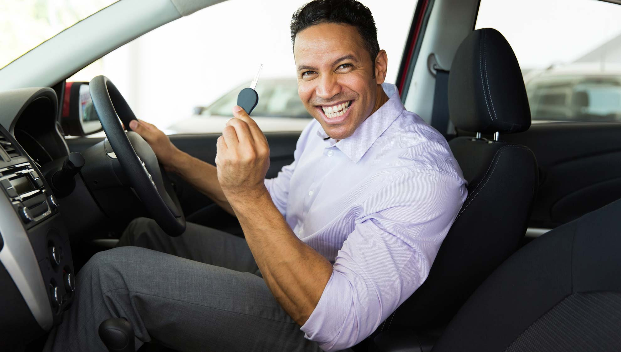 Happy driver getting car key