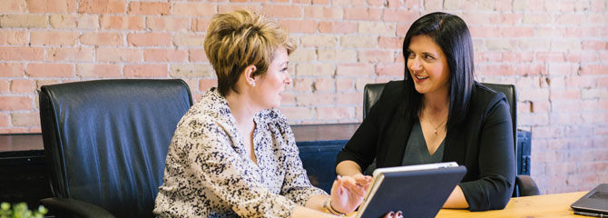 women meeting to discuss finance options
