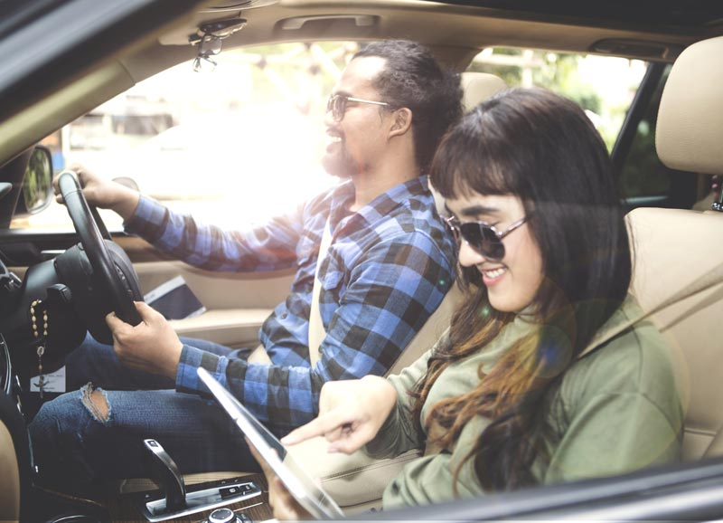 Happy couple driving